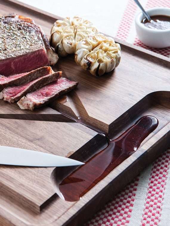 jk adams walnut rectangle carving board lifestyle steak angle pop